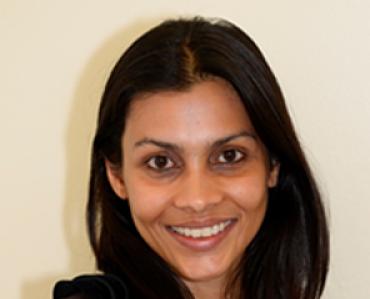 Headshot of Dr Rao smiling